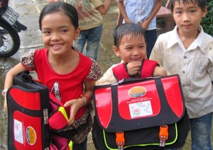 Vietnamese children with backpack life vests